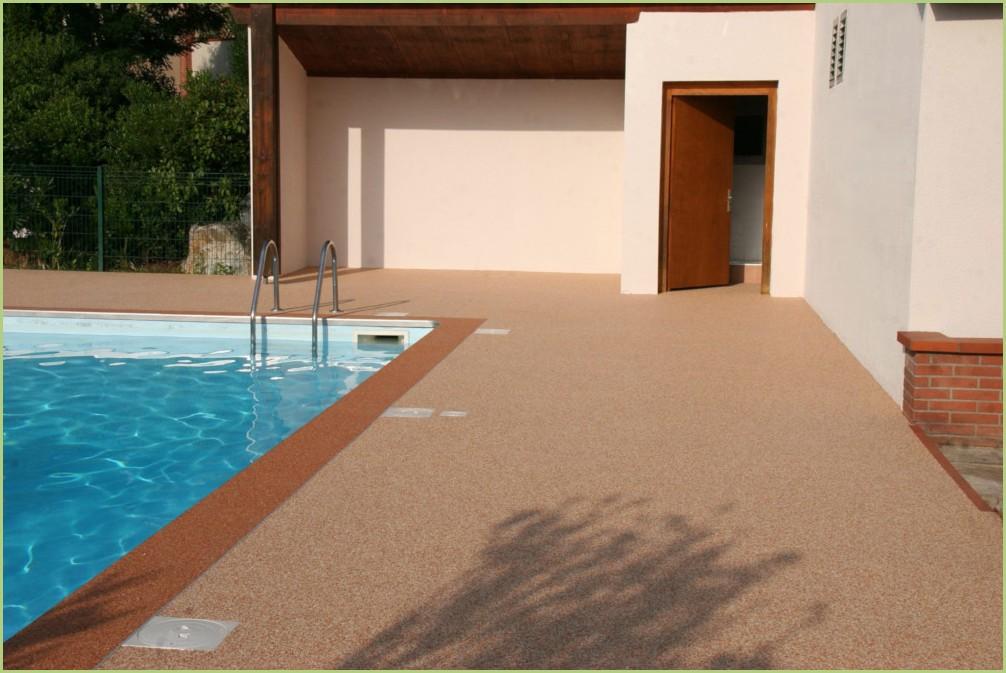 Sol décoratif drainant d'une plage de piscine - Après
